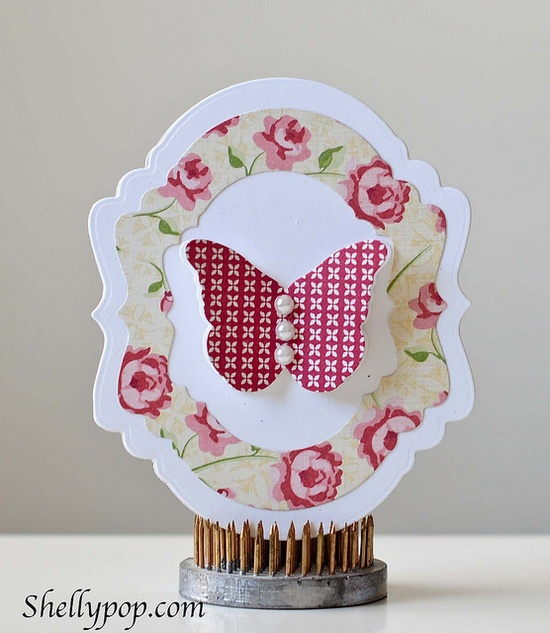 beautiful handmade card ... fancy frame shape card Nesting Frames 9 by popsicletoes3 ... like the use of patterned paper for one of the framed layers ...
