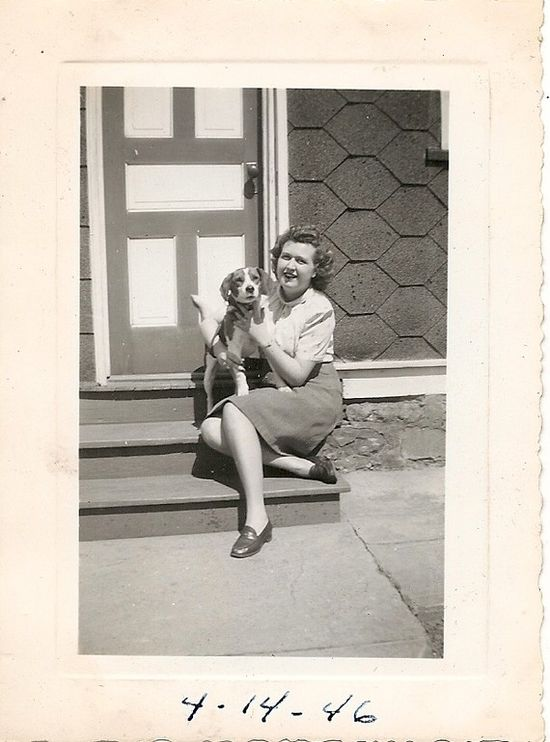 1940s photo of woman holding a beagle.