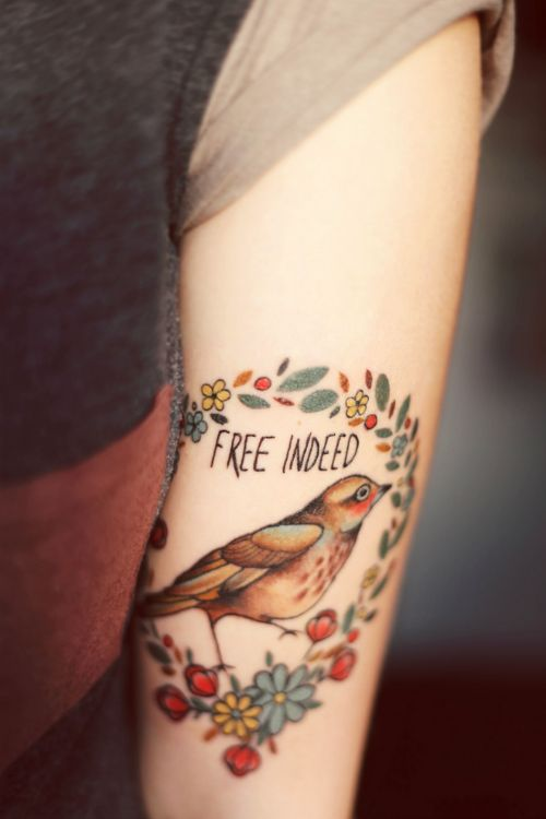 """free indeed"" bird tattoo"
