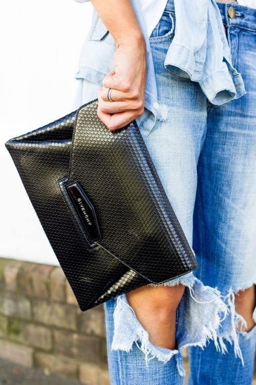 ripped denim / classic black clutch.