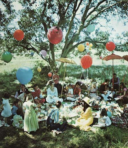 The perfect picnic, a checkered blanket, a woven basket, and a whole lot of family and fun all under a shady tree