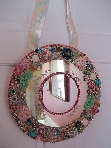 Vintage jewelry mirror!  Great idea for vintage brooches, earrings and beads!  We have lots of vintage jewelry at www.hendersonmemo...