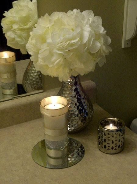 My bathroom decor        -Walmart vase ($6.99)        -Flowers Pier 1 ($6.99ea.)        -Dollar store mirror (pack of 3/$1)        -Walmart tea light holder ($3.99)        -Glass with ribbon (DIY from my