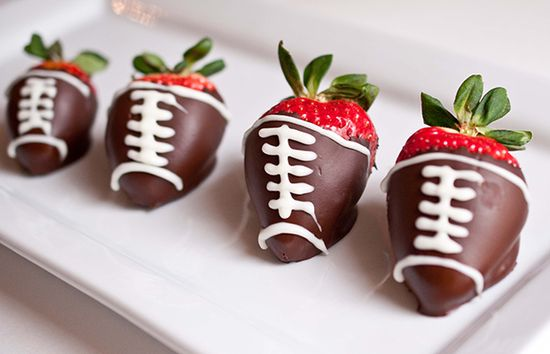 Save a few of these for halftime! Easy-to-make chocolate-covered strawberry footballs are sure to bring home a win.  #healthy #dessert