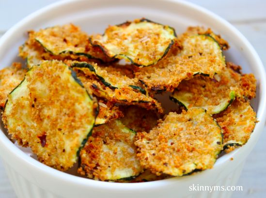 Skip the processed bag of chips, and replace it with these fantastic Oven Baked Zucchini Chips. They're are only 99 calories per serving. #chips #zucchini #snack #healthy #unprocessed