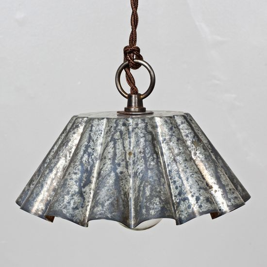 Tin Pendant Barn Light -  classic tin with a shiny, etched patina. Hung upside down, forming the perfect lampshade, this tin is accented by a twisted, cloth-covered cord. This would look cool over a basement bar or breakfast nook.