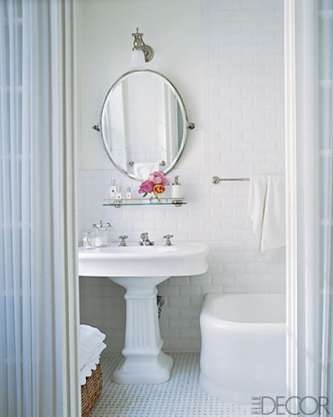 Classic white bath.  Subway tile, pedestal sink, vintage-style fixtures, and basketweave flooring.