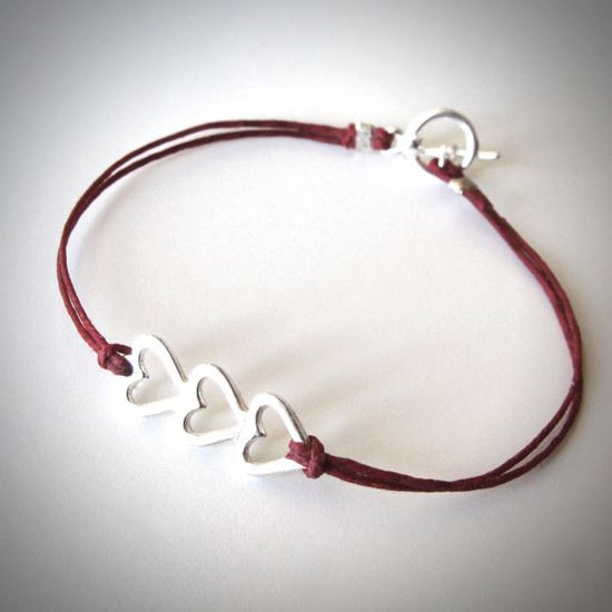 Sterling Love Love Love bracelet on red linen from JewelryByMaeBee on Etsy.