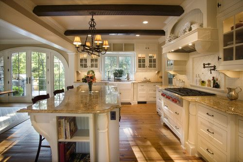 warm white kitchen. love the clean neutral theme against the rich dark beams ?