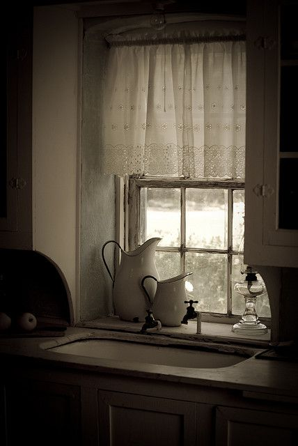 Window above sink - down to counter height - like it better.