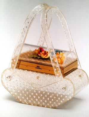 A gorgeous clear lucite handbag with multi-coloured flowers in cased in the lid. #vintage #handbags #purses #accessories