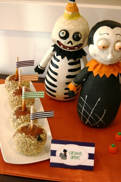 Caramel apples at a  Halloween Party.  See more party ideas at CatchMyParty.com.  #halloweenpartyideas