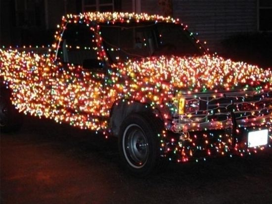 car pick-up truck in Christmas lights