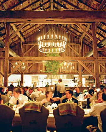 The chandelier inside this barn is simply stunning