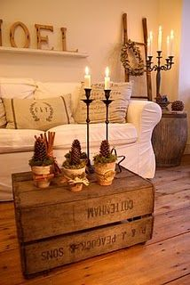 like the idea for a table Pottery Barn has similar ones but you can buy wooden boxes or a trunk or cut a table down and make a coffee table.