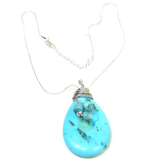 Big Turquoise Gemstone Teardrop Silver Necklace. $35.00, via Etsy.