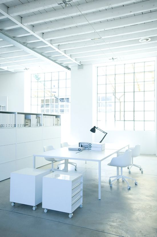 White workspace with giant table and lots of storage