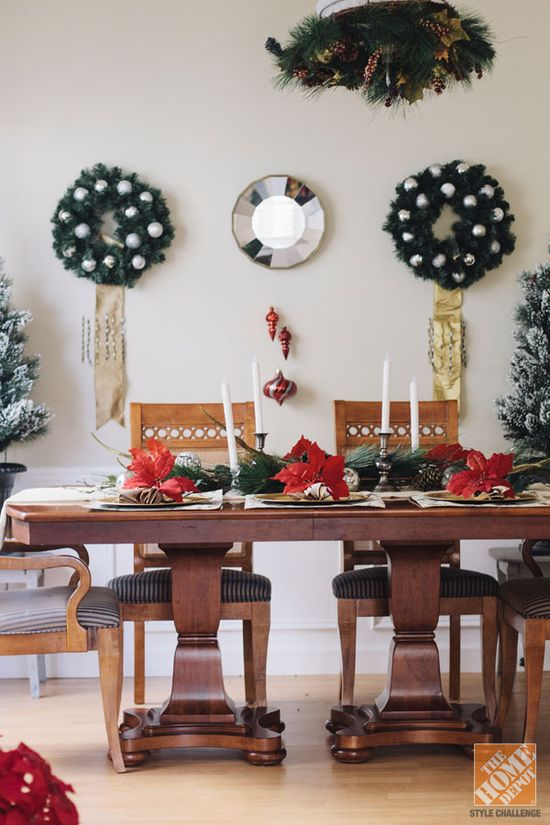 This holiday season, wreaths aren't just for doors. Follow Anna's lead and hang wreaths around the house - especially in your dining room!