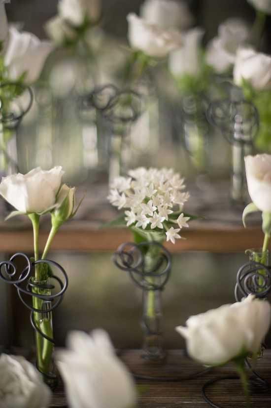 A sweet flower for each of the guests! Flowers by virtultd.com, Photography by harwellphotograph...