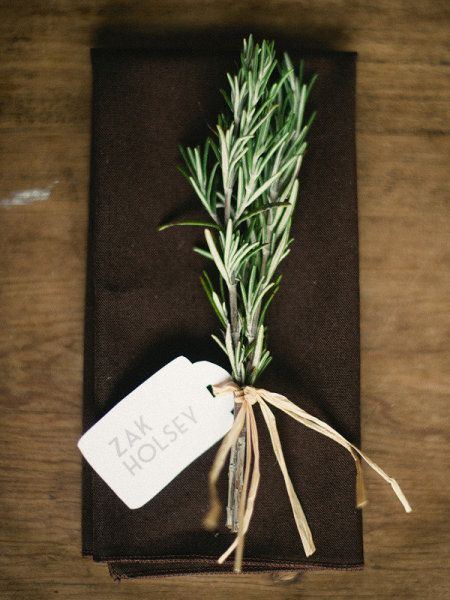 Place card tied to a sprig of rosemary
