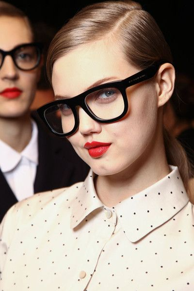 style guide: how to wear the geek chic trend - adore to hot tomato red lip color and studious glasses. Really good