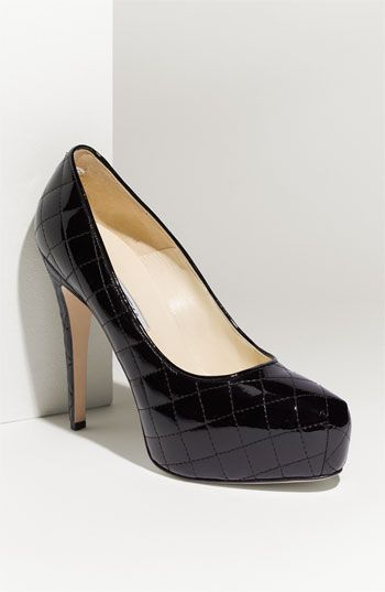 I love the twist on a basic black. Brian Atwood Quilted Patent Leather Platform Pump $650.00