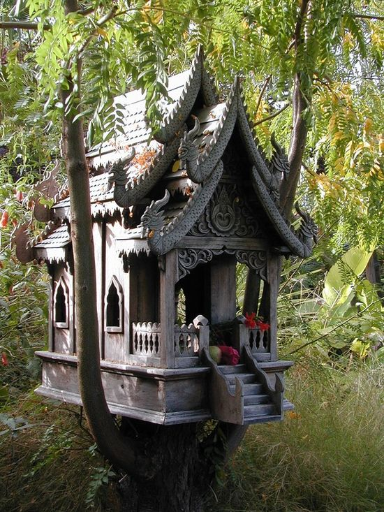 Whimsical birdhouse is truly a work of art