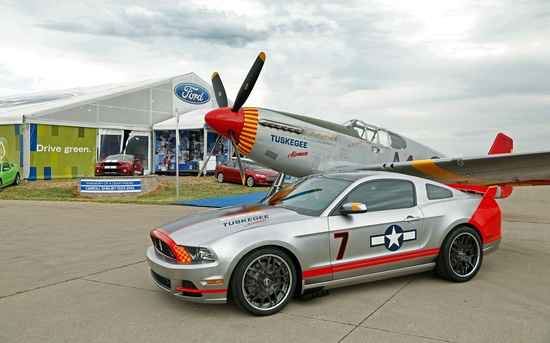 The 2013 Ford Mustang Boss 302 Red Tails Edition looks legendary next to a Tuskegee Airman WWII-era P-51C Mustang