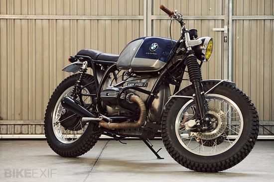 This custom BMW is from the Spanish workshop Cafe Racer Dreams. A 1978 R100/7, it amplifies the strengths of the vintage BMW aesthetic. The back end is completely new, sporting a hand-made leather seat and supported by Harley-Davidson XR1200 shocks rebranded with the BMW logo. Dig?
