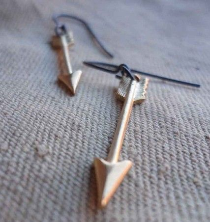 golden arrow earrings. // another feather jewelry