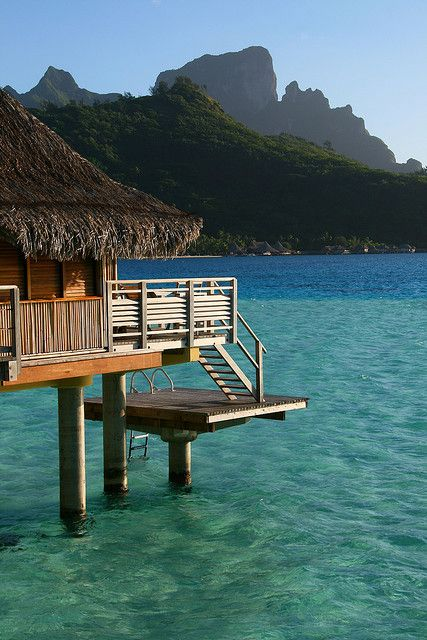 Bungalow, blue lagoon and the peaks of Bora Bora
