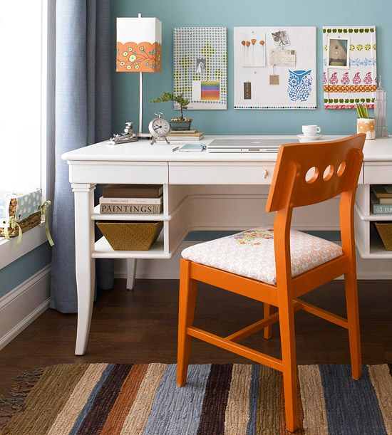 Make a corner desk a comfortable space by decorating it with bright accent colors. More pretty home offices: www.bhg.com/...