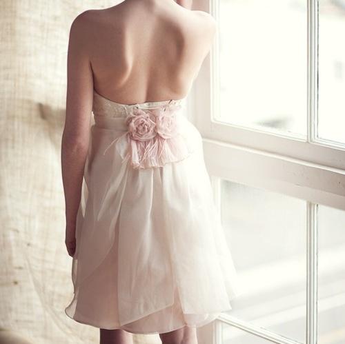 Romantic bridesmaids dresses with flowers.