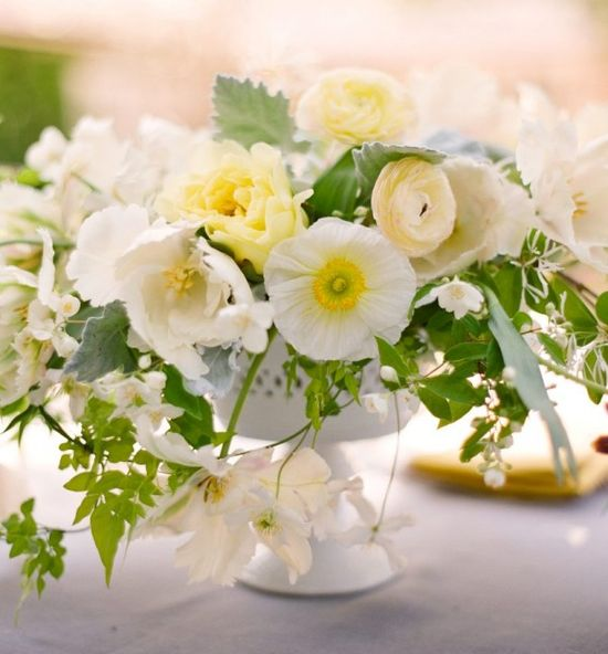 Absolutely perfect flowers by Ariella Chezar. The organic, undone arrangement is beautiful, especially in the milk glass compote.