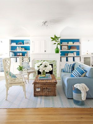Love the pops of blue.   Decorating with Color -