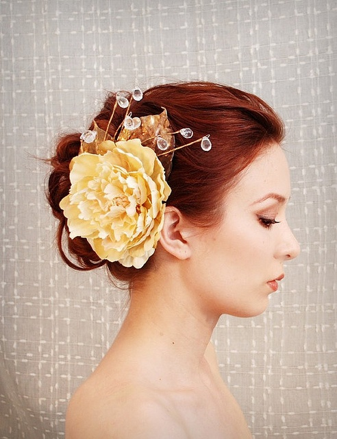 Updo with a big flower and crystals. Formal elegance