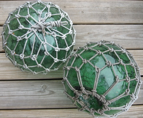 green Glass floats with fishing net, lovely for beach cottage coastal vintage style