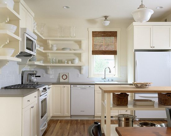 Small Kitchen Open Shelving Design including microwave hood and cabinets over fridge.