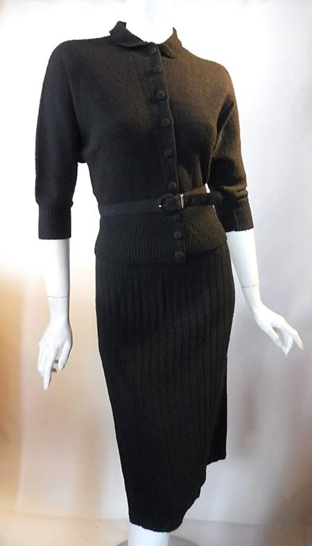 Black wool 2 piece knit dress with belted button down top, wide rib knit skirt. By Gloria Swanson.  (1940s)