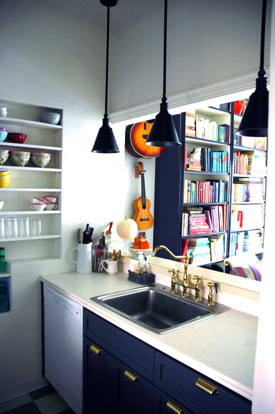 We love the way Jenny of Little Green Notebook used these black cone pendants in her kitchen -- beautiful!