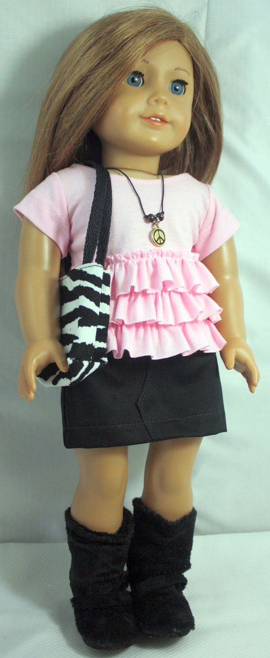 trendy top has three ruffles and black skirt with elastic (designer used Liberty Jane patterns)