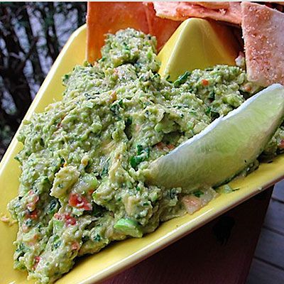 Edamame Dip with Lentil Chips is a much better option than guac and tortilla chips. Edamame adds filling protein to the mix, and lentil chips fill you up with fiber