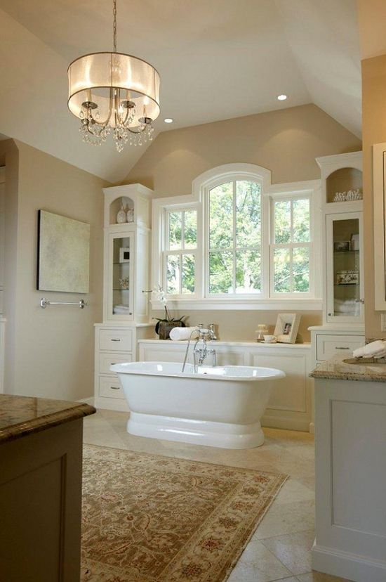 Such a beautiful bathroom....gorgeous tub and chandelier.