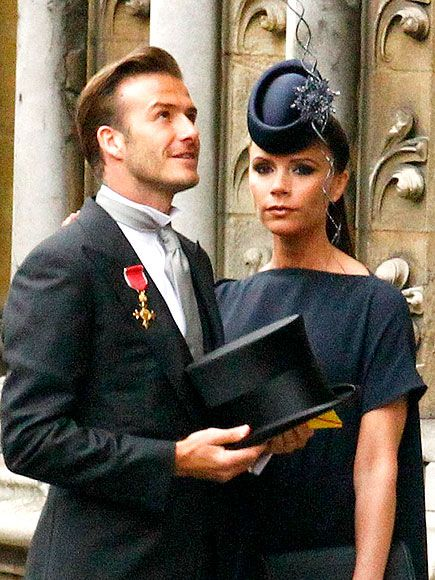 VICTORIA BECKHAM AND DAVID BECKHAM  The expectant star designer matches a swingy navy dress from her own collection to a dramatic floral Philip Treacy fascinator. Her handsome husband is by her side in a traditional top hat, also from Treacy, paired with his Ralph Lauren suit and Order of the British Empire.
