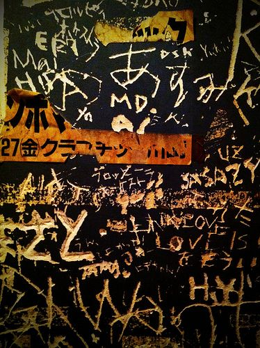 Scratched names (bathroom wall) (by ll_browneyes_ll)