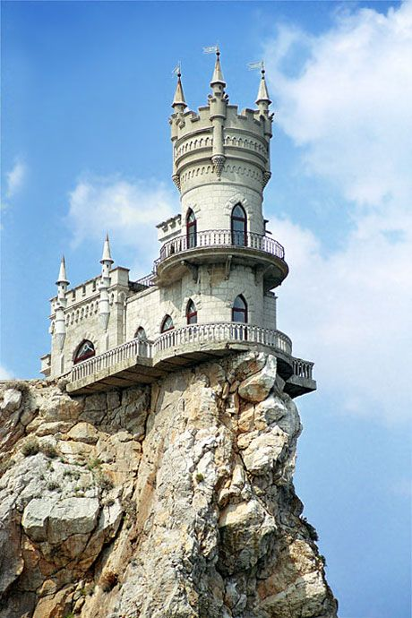 Palace Swallow's Nest; photograph by Tim Zizifus. Info from National Geographic: The neo-Gothic Swallow's Nest castle perches 130 feet (40 meters) above the Black Sea near Yalta in southern Ukraine. Built by a German noble in 1912, the flamboyant seaside residence now houses an Italian restaurant.