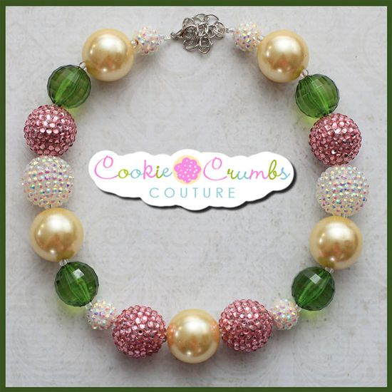 """garden lush is a fun new design with soft shades of pink, and greens beautifully placed for a calming, sweet necklace sure to match many of her outfits !   Handcrafted from quality items, our necklaces are not mass produced and are made to last! All of our necklaces are made to be approx. 16"""" with 4"""" in chain so that it can grow with your child and fit many ages."""