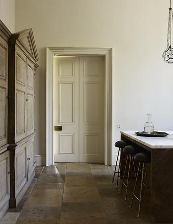 "Rose Uniacke Interiors - London SW1. Wonderful ""restored"" look - plaster walls, scraped hardwoods, high ceilings, marbled fireplace, minimal decor."
