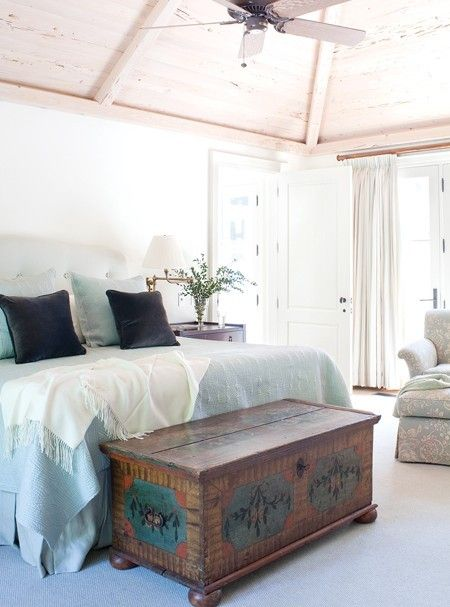 Love the antique trunk at the base of the bed