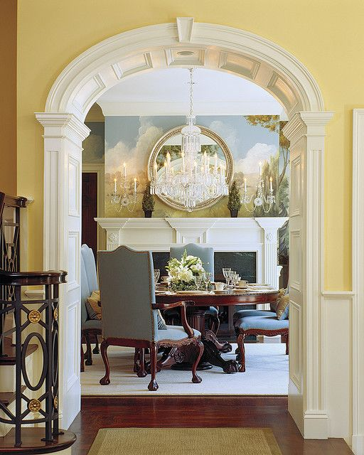 Gorgeous millwork! Love the mural and mirror in dining room!